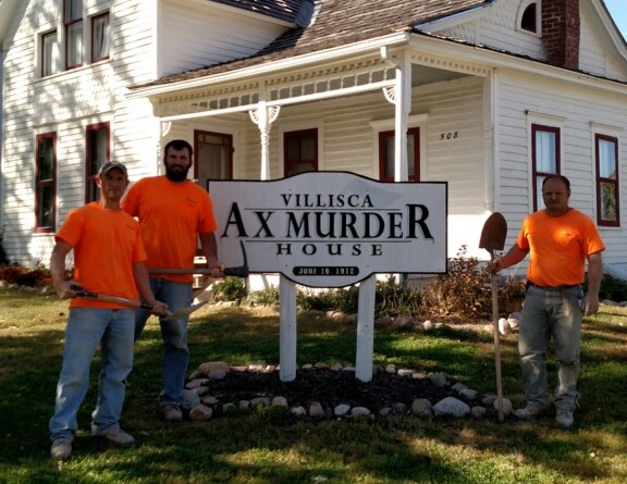 Members of the Basement RX crew standing outside the Villisca Ax Murder House in Iowa where they performed service.
